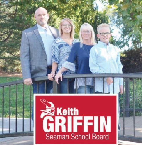 Family Time: Newly-elected board member Keith Griffin poses with his family behind one of his signs.