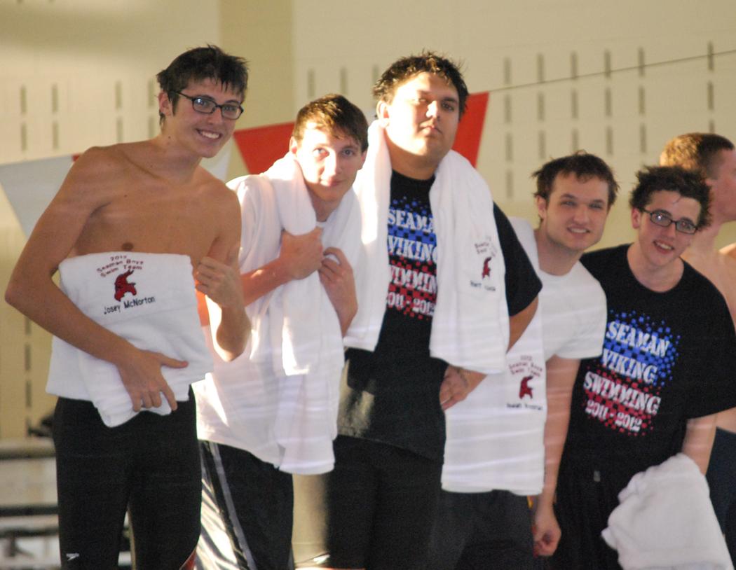 Senior swim team members Josey McNorton, Zach Henderson, Rhett Mosqueda, Isaiah Woodman and Ian Johnson,  accept towels from the parents during their Senior Night festivities.  (Photo by Kimberly Meader)