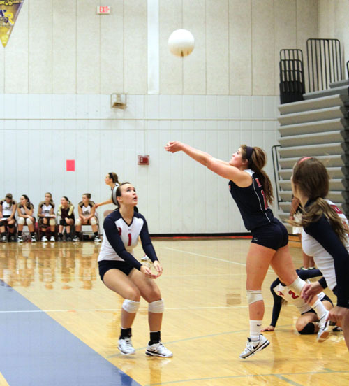 Libero Payton Summers digs the ball during a match at home.