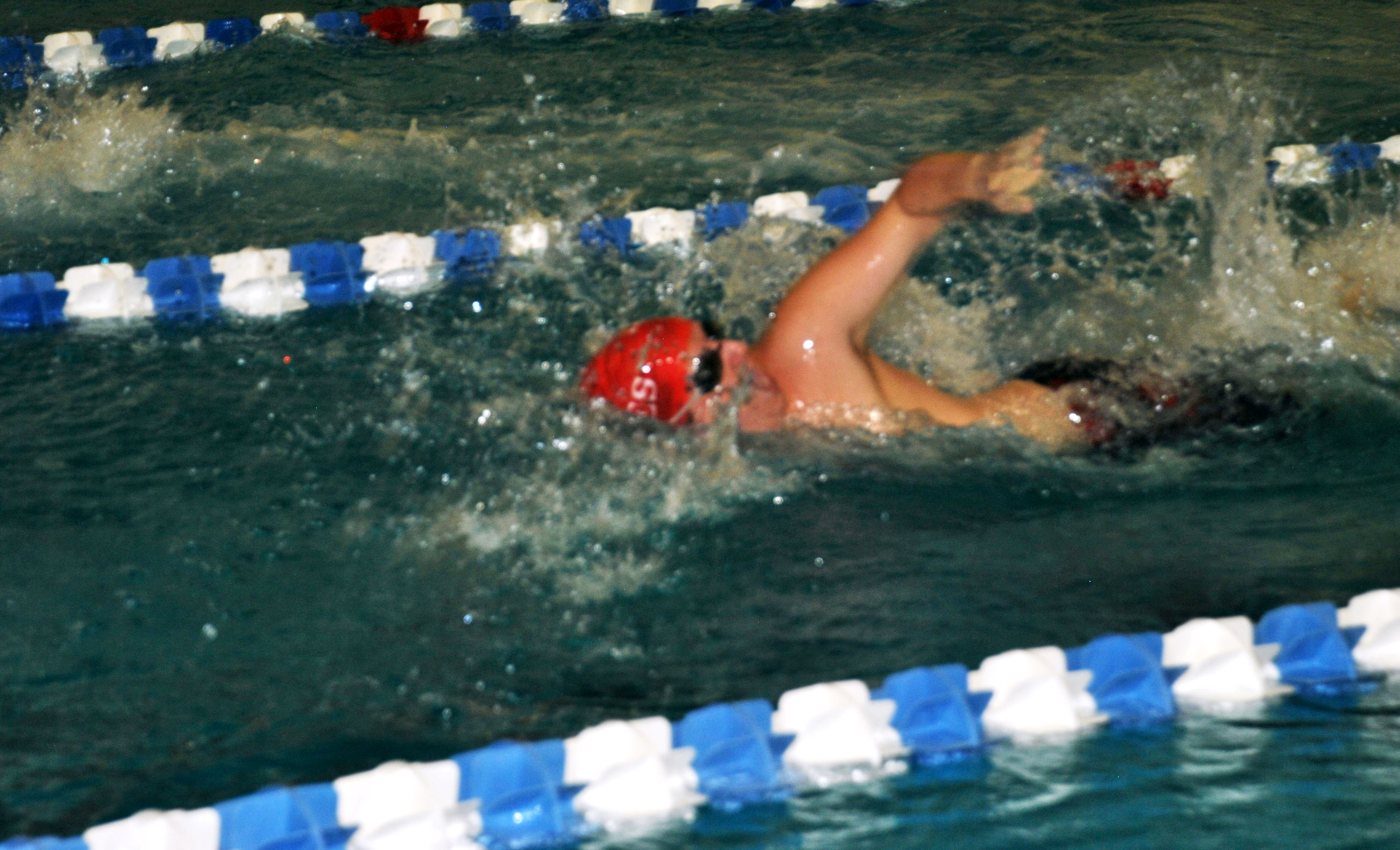 Senior Conner Henderson comes up for a breath during his 100 freestyle swim. (Photo by Karsen McCarter)