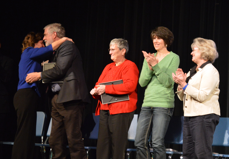Drs. Orozco and Balsters share a hug at the retiree recognition at the U.S.D. 345 Feb. 17 in-service.