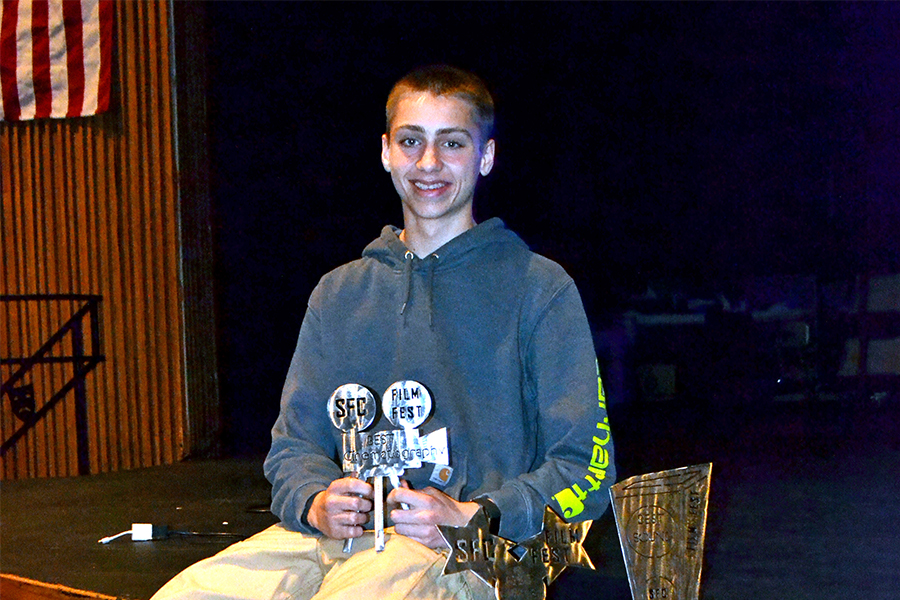 BUSY BOY Sophomore Collin Underwood poses with the trophies he made. He would spend over 10 hours on them.