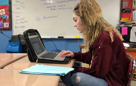 Kalie Kleiner, sophomore, working hard on a Berlin presentation about the Sachsenhausen Konsentrationslager, concentration camp. Kleiner believes school has been more stressful than Freshman year, saying,