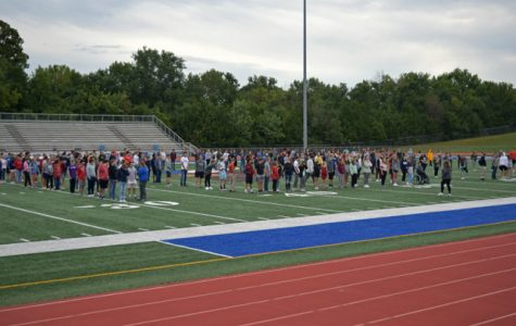 The Senior Class gathers in the football stadium to create a giant 100 celebrating the 100th class of Seaman High School. Anna Kennedy, one of the band directors, organizes the Vikings into formation.