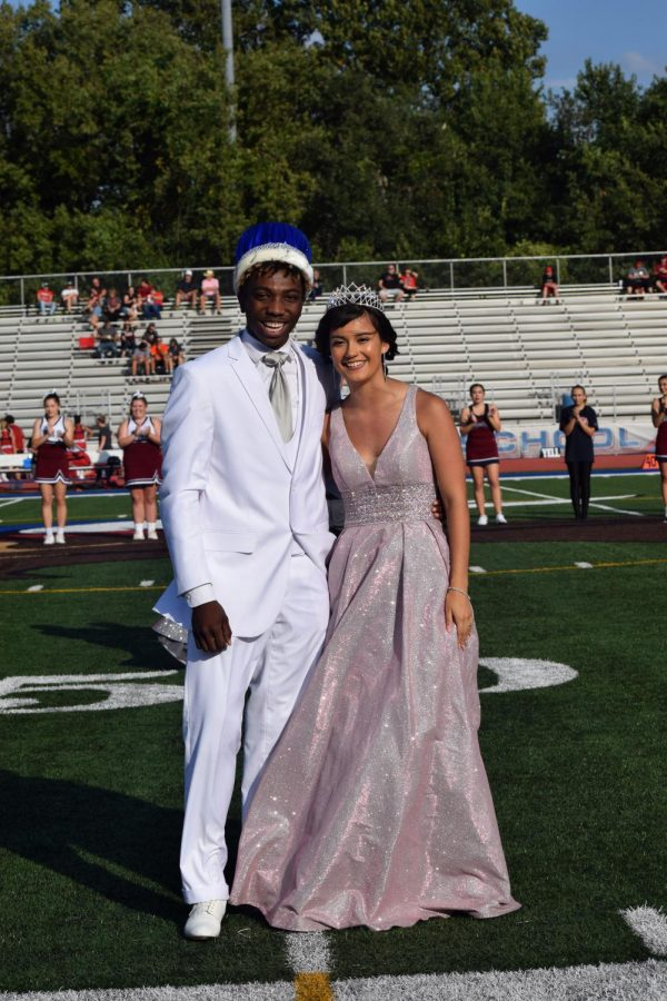Jr.+and+Isabel+smile+big+after+being+crowned+Homecoming+King+and+Queen+2019.+Jr.+and+Isabel+share+the+special+moment+just+after+being+crowned+looking+out+at+the+crowd+that+was+cheering+them+on.