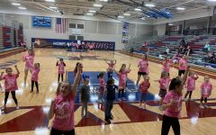 SHS cheerleaders teach elementary schools kids a dance. Jr. Vikes are preparing to perform at the game