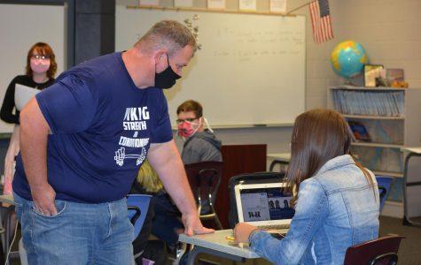 New Seaman Freshman Center teacher Jason Nichol helps a student during World History.
