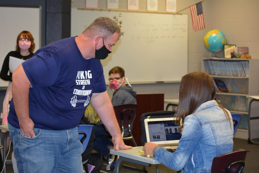 New Seaman Freshman Center teacher Jason Nichol helps a student during World History.