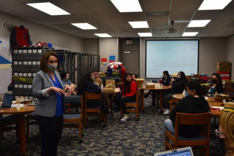 Administrator Danira Fernandez-Flores speaks to students about identifying themselves through name tags. The main meeting discussion would surround emotions encompassing the possibility of a district name change.