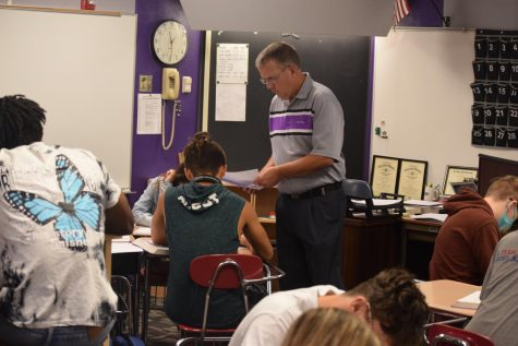 Mr. Blackman helps a student work through a math problem. Blackman relaxes into his role as returning math instructor.
